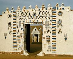"Africa | ""Painted doorway near Qûrta creates a blaze of color in a scorched land."" 
