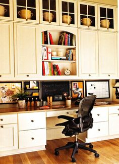 My upper cabs aren't nearly this high -- but I love the pinboard/corkboard, the chalkboard, and erasable calendar on the backsplash area in this photo. Hate the chair though!
