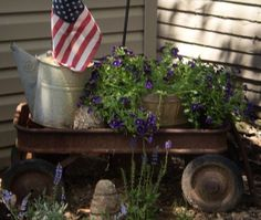 Using an old red wagon will add height and dimension to your garden. Just got one in our store yesterday!