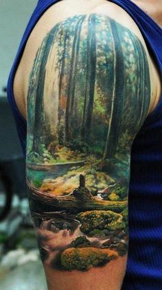 50 Insanely Gorgeous Nature Tattoos | Beautifully done! Very epic and all the colors stand out perfectly.