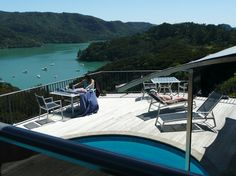 Waimanu Lodge Northland New Zealand. Guests painting and relaxing on the deck. Harbor View, New Zealand, Deck, Studio, Luxury, Painting, Decks, Painting Art, Studios