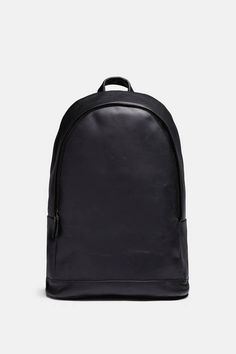 PB 0110 founder Philipp Bree believes in beloved objects: things that develop an individuality through daily use and become essential companions over time. This sleek black backpack is sure to do just that. Designed by Christian Metzner, it is crafted from vegetable-tanned cowhide and accented with Italian-made brass hardware. The streamlined exterior has a top handle, two reinforced and fully adjustable straps, and side pockets.