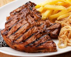Try our famous ribs or one of the many items off our sizzling grill menu. Served with Spur-style crispy onion rings and chips OR a baked potato. Crispy Onions, Grilled Pork Chops, Ribs, Baked Potato, Steak, Menu, Spur, Hot, Health