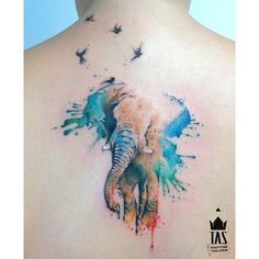 Water color elephant tattoo with  birds.