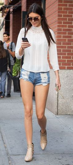 we'll take a white peasant blouse, distressed denim shorts, and booties with a side of Kendall Jenner please