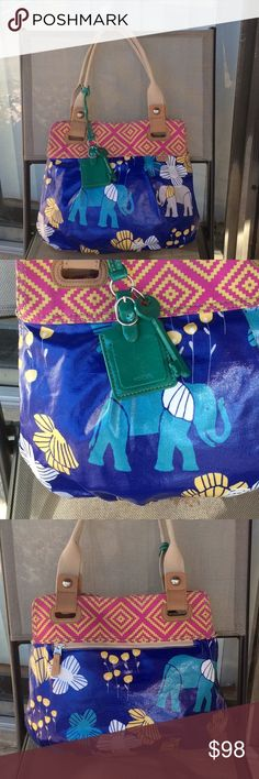 Fossil large coated canvas bag Like new,one zip pocket and two pouches inside Fossil Bags Shoulder Bags