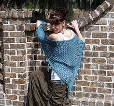 Belmondo Shawl A triangular shawl worked in a lattice pattern from tip to shoulders, with optional fringe. An open and lacy stitch kn. Crochet Shawls And Wraps, Knitted Shawls, Crochet Scarves, Shawl Patterns, Knitting Patterns, Knitting Projects, Belly Dance Scarf, Aran Weight Yarn, Crochet Triangle