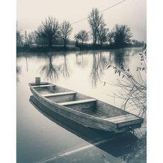 Wooden boat on the river Korana.