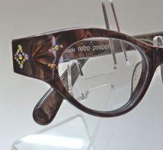 this is 'GLORIA' a beatiful remodelled cat eye taken from an original 1950's frame. She's available in two colours, Coffee Pearl and Sunset Pear. At my website www.retropeepers.com where I specialise in designer vintage styled spectacle frames