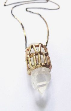 heavy metal. gold case necklace. gemstone necklace.
