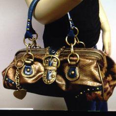 Nine West bag Beautiful blue and animal print duffel style bag Nine West Bags