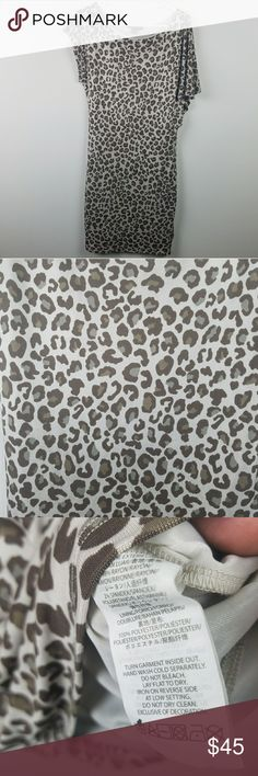 """Armani Exchange Animal Print Dress Size Small Beautiful Animal Print Dress. Mismatched sleeves make it very sexy. Great dress for travel because of the fabric. Approximate measurements flat  Bust 19"""" Length 38"""" Armani Exchange Dresses Midi"""