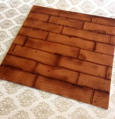 Wooden floor effect cake board made with fondant and air brushed.