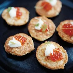 Cauliflower Fritters | To create these wonderful tapas, José Andrés makes a batter with crunchy nubs of chopped cauliflower florets, fries spoonfuls in a skillet and then tops the fritters with yogurt sauce and a dollop of caviar.