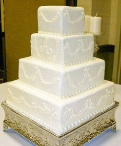 All white buttercream square wedding cake