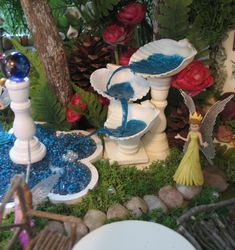close up of sea shell fountain  and gazing ball pool