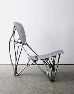 Bone Chair - I love the way the organically sculpted aluminium Bone Chair, by Dutch designer Joris Laarman, looks like it has just grown out of the ground.
