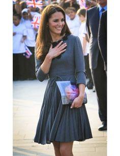 The sleek, futuristic clutch works so well with her vintagey dress. #katemiddleton