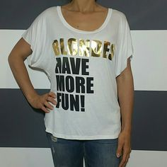 """Blondes have more Fun"" top Sassy ""Blondes have more fun"" top. Semi High low style. Gold and black lettering. Comfy, flowing style.  Sleeves have an unfinished edge Length in front approx24"",length is back approx 26"" 95%rayon 5% spandex Size medium Tops Tees - Short Sleeve"