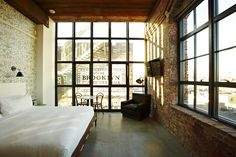The Historic King Room of the industrial-chic Wythe Hotel in Brooklyn, NY. a 1901 waterfront factory transformed into a beautiful hotel which carefully preserved the brick masonry, loft-style windows and pine beams. Loft Interior, Interior Architecture, Interior And Exterior, Industrial Interiors, Industrial Chic, Industrial Windows, Industrial Living, Industrial Apartment, Industrial Wallpaper