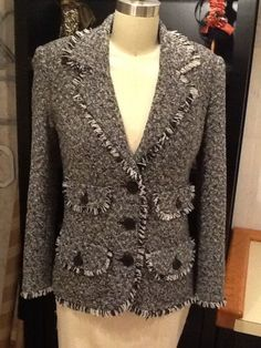Chanel inspired jacket was made of soft Italian wool tweed. The pattern is my own design and itwas constructed using couture hand techniques. The sleeve vents were faced with bias cut facings...