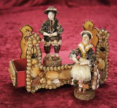 In the Company of the Gentleman Bespoken: 22 Pair of 19th Century Papier-Mache Seashell Dolls and Candy Container Bed