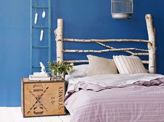 Use what nature gives. Gather up broken branches and twigs from the back yard to create an eco-friendly recyclable headboard. Use colorful thread to tie the twigs together in a random pattern to achieve assymetric headboard.
