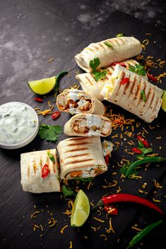 Healthy grilled chicken and parsley wraps, loaded with cheese, served with greek yogurt deep, chillies and lime slices - stock image . Healthy Grilling Recipes, Healthy Tacos, Easy Healthy Recipes, I Love Food, Good Food, Yummy Food, Mexican Food Recipes, Snack Recipes, Cooking Recipes