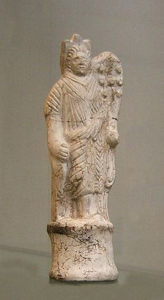 Gallo-Roman mould-made pipeclay figurine of the goddess Fortuna, made in Cologne. 2nd centurr AD. Ht. 17.8 cm. British Museum, London. GR 1949.10-11.54