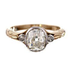 Antique Oval Cut Diamond Platinum & Yellow Gold Ring