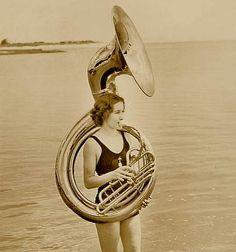 tuba girl by the sea shore