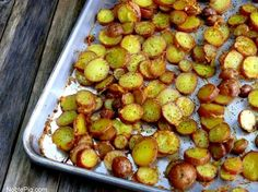 Cheesy-Crushed Rosemary Roasted Red Potato Coins (would love to swap in duck fat for the olive oil!)