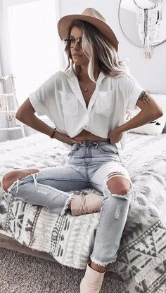 stylish woman wearing street style high waist rips + blouse and nude details