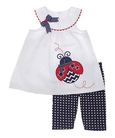 Take a look at this White & Navy Ladybug Tunic & Capri Pants - Toddler on zulily today!