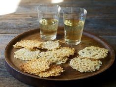 These Frico or Friulano Cheese Crisps from The Country Cooking of Italy are the perfect little bite to go along with the pre-dinner drink. Savory and salty, crisp and cheesy, they have the munchability of a potato chip with an apertivo-level elegance.