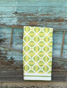 LOVE this pattern! Will probably do a lighter, more subtle color to work with my room. (Though the citrus tones make for a great summer quilt)