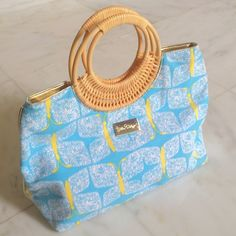 """Lilly Pulitzer Beach Bag Lilly Pulitzer Beach Bag, blue/yellow cotton butterfly pattern (18.5"""" at widest & 11.5""""at highest), waterproof gold material on bottom(14""""x6"""") & top 4"""" of lining, woven wooden circle handle (3.5"""" from top of bag, 7""""diameter), pink cotton lining w/one zip pocket (7"""" across) & gold button lining, used-great condition Lilly Pulitzer Bags Totes"""