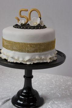 like the cake on the black pedestal but not the cake so much~~50th Wedding Anniversary Fondant Cake