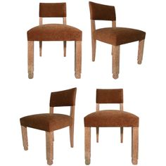 These 1930s French chairs feature columnar, squared front legs which are offset by slightly flared back legs, all in cerused oak. The chairs have been recently reupholstered in fawn velvet.