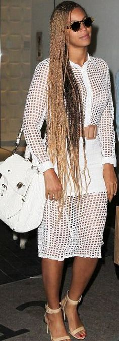 Who made Beyonce Knowles' long sleeve top, sunglasses, and cut out skirt?