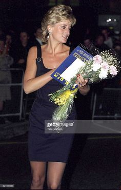 September 7, 1995: Diana, Princess Of Wales, Carrying The Film Programme And Bunches Of Flowers As She Leaves The Film Preview Of The'apollo 13' In London.