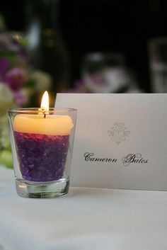 glass + purple rocks + tealight candle = table decoration