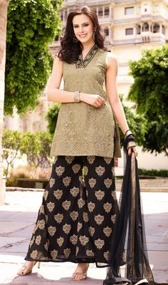 Be the charm in your onlookers eyes as you step out in this beige embroidered net palazzo suit. You will see some interesting patterns performed with jaal, resham and stones work. #MelodicBeigeEmbroidredBlackPalazzoSuit