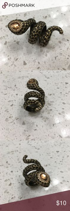 LAST CHANCE! Avon Snake Statement Cocktail Ring Approximately a size 7. This item will soon be going to a local consignment store and it will be taken off Poshmark.  Make me an offer!  Bundle more items to save! Avon Jewelry Rings