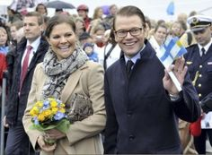 Crown Princess Victoria and Prince Daniel of Sweden wave to the crowd after they arrived in Turku