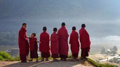 Novice monks at the Dechen Phrodrang Buddhist monastery look down from a hilltop in Bhutan's capital Thimphu, on October 12, 2011.