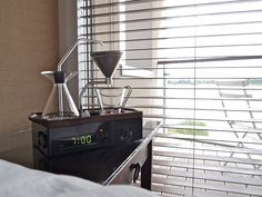 """The Barisieur is an alarm clock that will wake you up with a bespoke cup of coffee right when you need it most. It challenges all 5 senses, easing the user into the day with the subtle movement of stainless steel ball bearings that boil water via induction heating, accompanied by the smell of freshly brewed coffee or tea. Nightly prep encourages a """"ritual"""" before bed, signalling to the body that it's time to unwind and that there's something to look forward to in the morning!"""