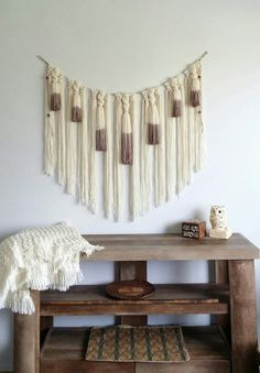 This is a macrame yarn wall hanging that would make a great statement piece above a bed or sofa. I have macramed and twisted acrylic yarns to jute twine. I dip dyed the tassels a brown/mauve. I have attached wooden beads to the side jute twine strands and created loops on each side for easy hanging. Feel free to message me for any questions.  Dimensions-  38 wide  30 long yarn strands in center.