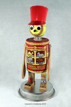 'Barnum' ~ Found object/junk art created by Laurie Schnurer in 2015. Tin's lid comes off to store items inside. To purchase one of Laurie's Creatures go to https://www.facebook.com/LauriesCreatures.