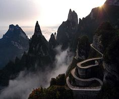 Heaven Linking Avenue – Hunan Province, #China. This truly is a path to #heaven, with 99 turns to symbolise Heaven's nine palaces, leading you road directly into the clouds.  Click on the image to see the world's most breathtaking roads...